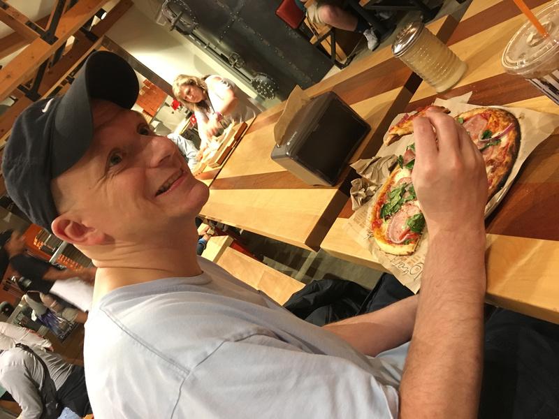 Bryan enjoying his pizza